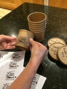 Kezi Applies Our Lovely Labels To Our Kraft Pots